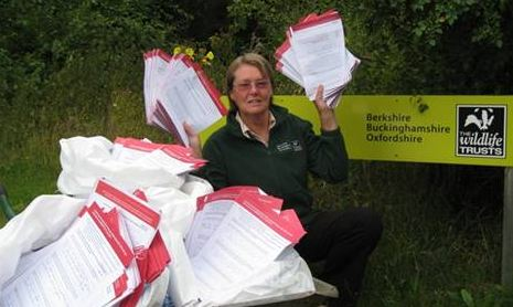 Philippa Lyons with 2,000 responses from Wildlife Trust members against the proposed HS2 route through Bucks & Oxon